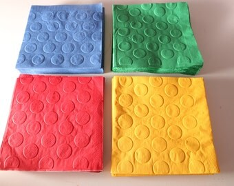 Pack of 48 beverage sized Lego inspired party napkins in primary colors.