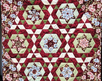 Kaleidoscope quilted wall hanging small lap wheel chair quilt burgundy pink and green