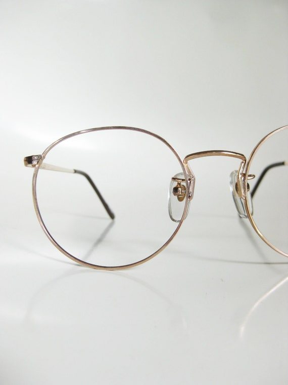 i dont need glasses anymore but my girlfriend wears circular gold wire frame glasses not perfectly round more like this