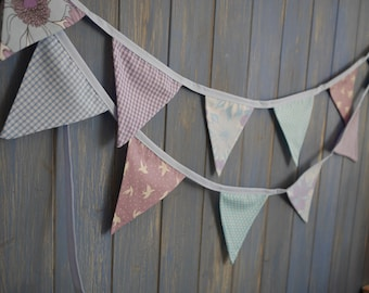 Small Classic Bunting. Colours - Lilac and Blue. Patterns - Retro Flowers, Gingham, Spots and birds. This strand is 3m long.