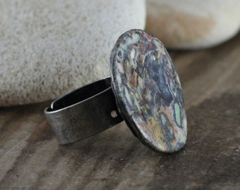 Recycled Magazine Paper Layered & Shaved on Bottle Cap with Polymer Clay Back on Adjustable Ring Base