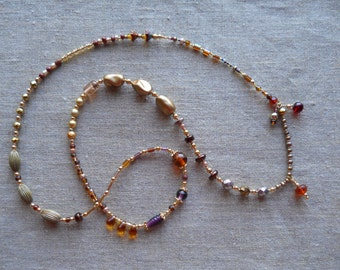 Garnet handmade/red/gold/lavender necklace/ freshwater pearls/Czech glass beads/fun handbeaded dangles, 1/4 turn strand/goes with everything