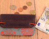Wallet of gray and burgundy leather with red accents
