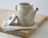 Hand thrown stoneware coffee pot - glazed in vanila cream with leaf pattern