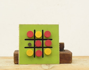 Vintage metal Tic Tac Toe game board with magnetic wooden game pieces