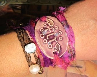 WRAP BRACELET ceramic FLY design with Wings in pretty Purple and recycled sari silk wrap ribbon in deep Pink and Purple