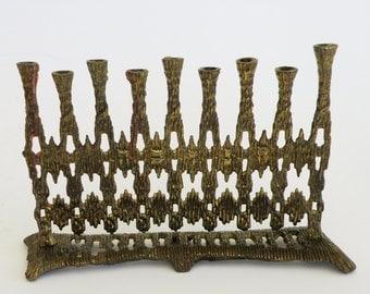 "A vintage solid brass chanukah menorah by ""Hein ami"" Israel"
