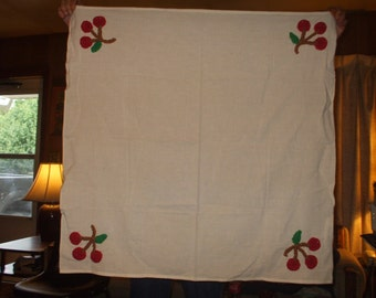 muslin tablecloth with crocheted cherries appliques