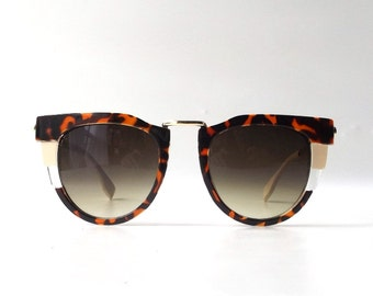 vintage 1990's women oversize sunglasses cat eye brown tortoise shell plastic gold metal frames fashion accessories retro modern sun glasses