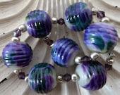 Destash Lampwork beads by Judith Billig purple rounds x 7