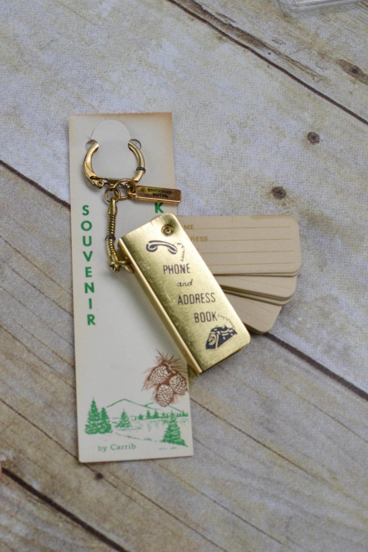 vintage souvenir keychain tiny phone book tiny address book