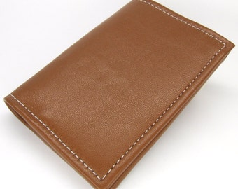 Tan leather wallet with four card slots, notes pocket, denim lining