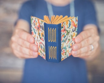 Tiny handmade book with classic Italian pattern on covers