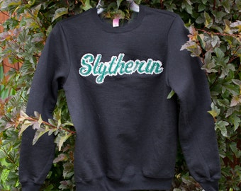 Harry Potter-GIRLS JUNIOR Distressed Applique Crewneck Sweatshirt-Pick a House!  Are you a Ravenclaw Gryffindor Hufflepuff or Slytherin fan?