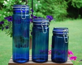 Cobalt Blue Glass Side Clamp Canisters, Set of Three Descending/Ascending in size, Paneled Design, Storage Containers.