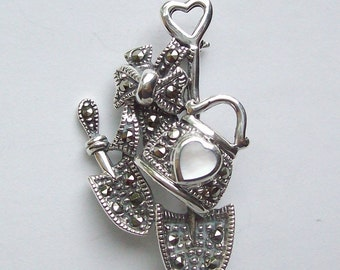 Vintage sterling marcasite brooch mother of pearl heart purse shovels tied with a bow 1980s marcasite pin free shipping to USA