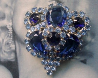 Unsigned Beauty. Sapphire Blue Open Back Teardrop and Chaton with Rosettes Brooch
