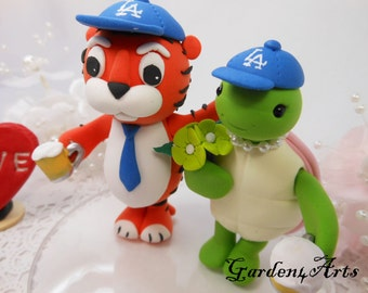 Wedding Cake Topper-- Love tiger and turtle with baseball caps/beer cups and circle clear base--New