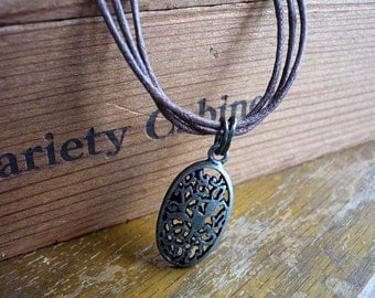 Bird and Leaves Pendant on Brown Triple Cord Necklace