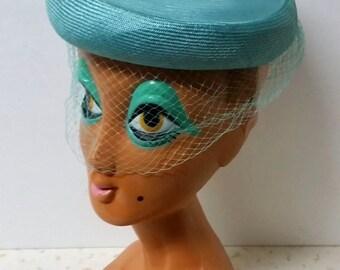 Beautiful Aqua Pillbox Hat With Birdcage Veil and Roses