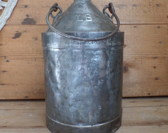 Old french metal bottle container for storing oil