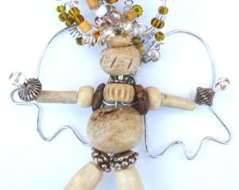 Our Angel Brooch is named Anna made with beautiful wood tone beads and wonderful beaded hair.