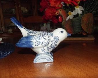CBK LTD, LLC blue and white perched bird 1998