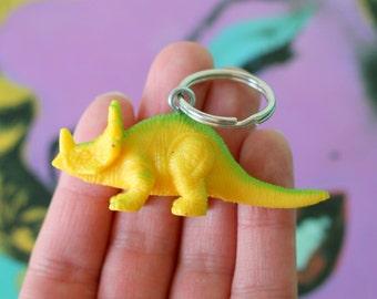 DINOSAUR Keychain..dangly. novelty. dino. retro. science. kitsch jewelry. plastic toy. yellow dino. dino crazy. jurassic park. brachiosaurus