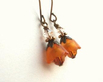 Small flower earrings, orange lucite, antiqued brass, Austrian crystal, Fall earrings. Orange jewelry
