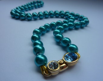 String of Pearls: Glass pearl necklace in Teal Blue, hand knotted on silk with blue and clear rhinestone clasp