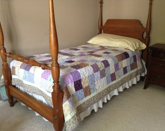 Mixed purple patchwork twin quilt