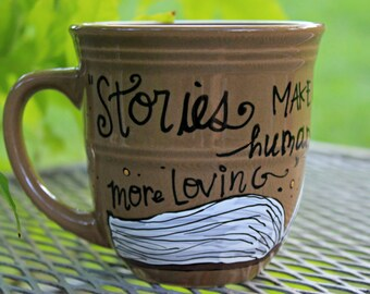"Madeleine L'Engle ""Stories make us more alive"" Hand painted, large rustic brown mug - Literary - Open book design"