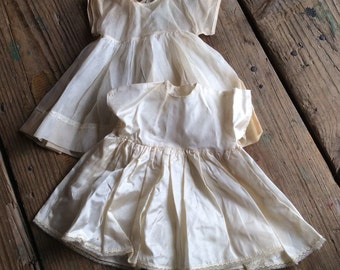 Two Vintage Shabby Cream Doll Dresses