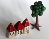 Set of three red miniature houses