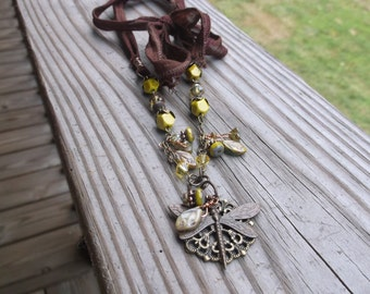 Silk ribbon Picasso glass dragonfly, flowers, and leaves necklace