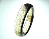 handmade resin filmstrip bracelet . vintage countown leader film . start frame and number 8 . black and white