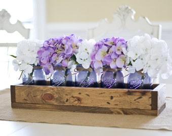 Rustic Planter Box with Vintage Purple Mason Jars. Vintage Blue. Vintage Purple. Rustic Wedding Centerpiece. Mason Jars. Mason Jars. Rustic.