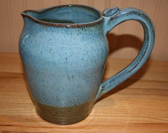 Large blue pottery pitcher, great for ice tea or use as flower vase