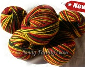 """Naturan Sheep Wool yarn """"horce"""". Multicolor wool yarn in red, green and yellow. Color 308."""