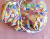 SassyCloth one size pocket cloth diaper with sugarcrush candyland PUL print. Ready to ship.
