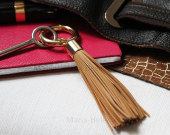 tassle accessory in light brown leather