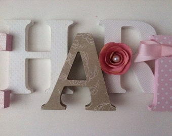Wooden letters for nursery in pink, white and taupe