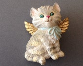Cute cute cute kitten with golden wings resin pin from the 1980's