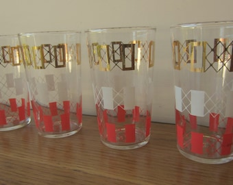 Set of four Mid Century glasses.  Atomic era red white and gold geometric drink ware.
