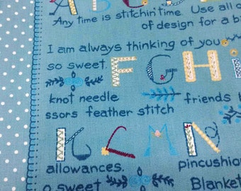 SALE - Alphabets and dots, on blue, 1/2 yard, pure cotton fabric