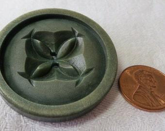 "Large, 1.5"" ins moss green vintage 2 hole coat button. Nut or vegetable. Stylized Tudor Rose design. Raised rim. UNK12.4-15.3-6.29."