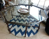 Brass table with tortoise shell legs. Octagon.  Vintage table
