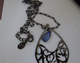 17 1/2inch BLACK CHAIN with blackened metal PENDANT and dark blue glass drop. Clasp is black lobster clawn perfect condition
