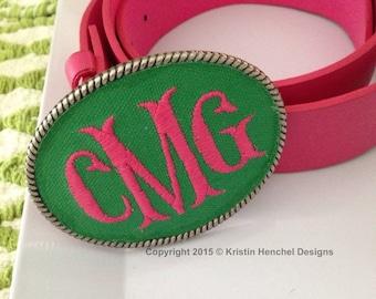 Kristin Henchel custom women's monogram belt buckle - fish tale monogram. Green fabric with hot pink thread