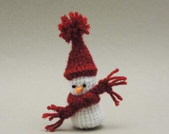 Crochet Amigurumi Snowman in a tall red hat